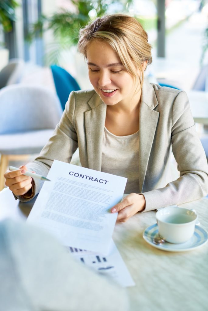 Young Business Woman Presenting Contract